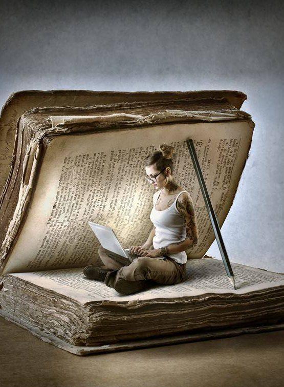 Girl sitting in a book writing