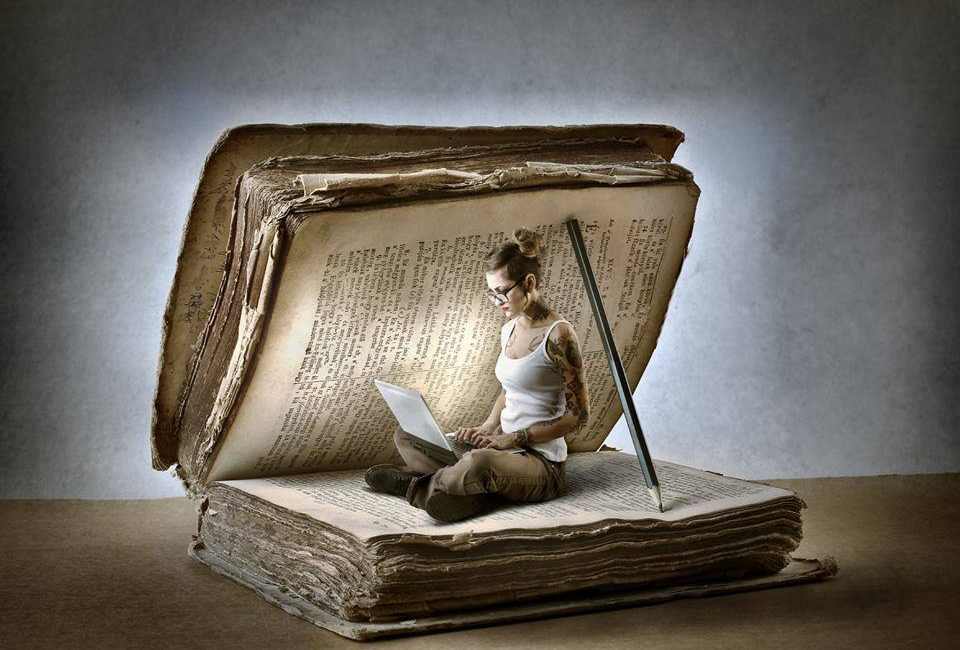 Girl sitting in a book writing